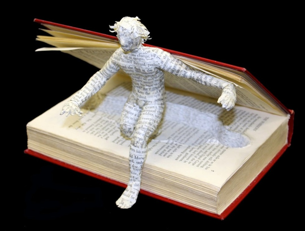 person jumping out of book