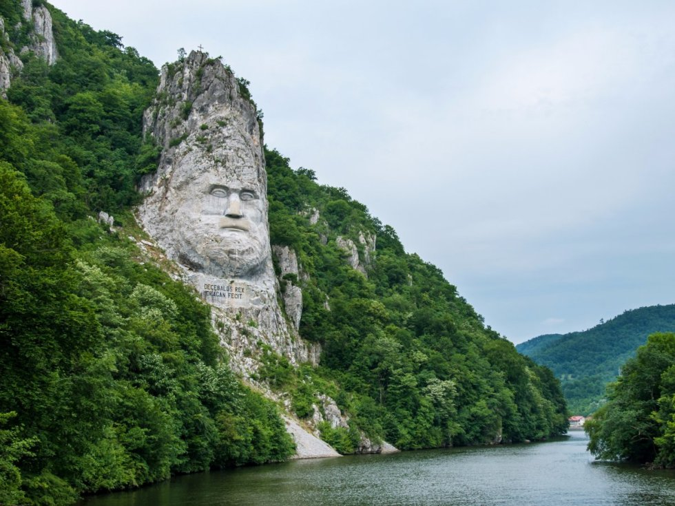 this-rock-sculpture-of-the-face-of-decebalus-dacias-last-king-is-carved-on-a-jagged-outcrop-of-the-danube-river-near-the-city-of-orsova-in-romania-the-131-foot-high-carving-is-the-talles